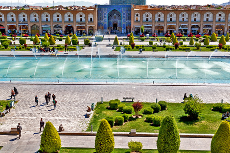 esfahan: blur in iran   the old square of isfahan prople garden tree heritage tourism and mosque Editorial