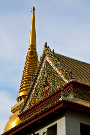 krung: asia  bangkok in   temple  thailand abstract   cross colors roof      and    colors religion mosaic  sunny Stock Photo