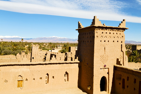 bastion: brown old  construction in  africa morocco and  clouds  near the tower Stock Photo