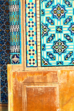 iran the old decorative flower  tiles from antique mosque like background
