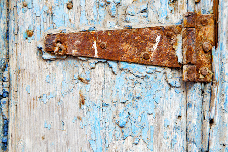 rusty nail: morocco in africa the old wood  facade home and rusty safe padlock Stock Photo