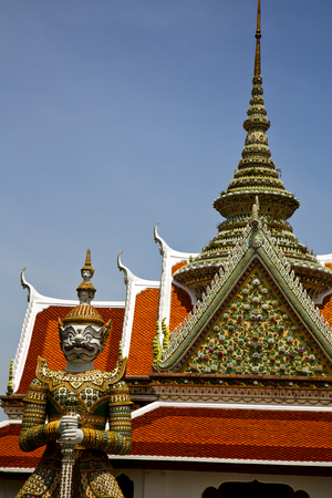 asia  bangkok in   temple  thailand abstract   cross colors roof  wat    sky   and    colors religion mosaic  sunny