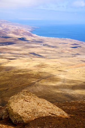 panoramas: coastline lanzarote view from the top in  spain africa and house field  Stock Photo