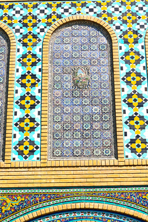iran mosaic: blur in iran the old decorative flower  tiles from antique mosque like background