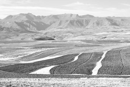 blur  in lesotho malealea street village near  mountain and coultivation field