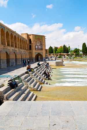 blu in iran  the old bridge and the river antique construction near nature