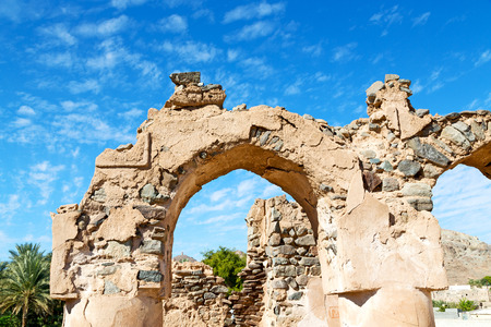 oman background: arch village house and  cloudy sky in   oman the old abandoned