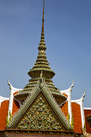 asia  bangkok in   temple  thailand abstract cross colors roof  wat    sky   and    colors religion mosaic   rain Stock Photo