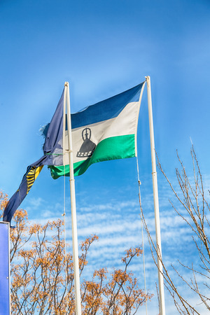 blur  in lesotho waving national flag in the cloudy sky