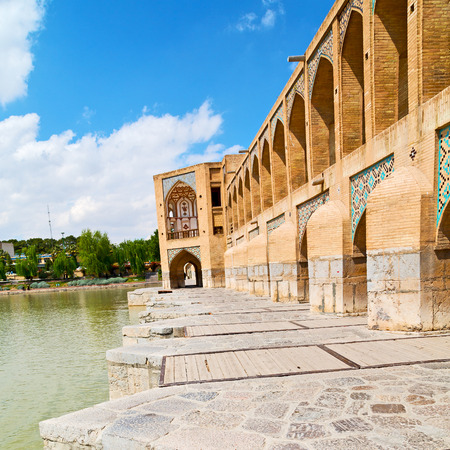 esfahan: blu in iran  the old bridge and the river antique construction near nature