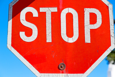 traffic pole: the stop signal write  in south africa  and sky