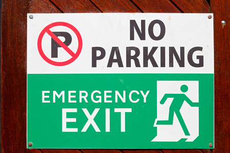 building wall: blur  in south africa  emergency  exit signal and no parking icon