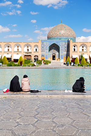 imam: blur in iran   the old square of isfahan prople garden tree heritage tourism and mosque Stock Photo