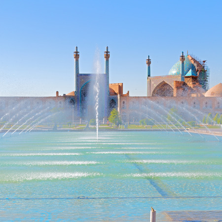 square: in iran old square mosque and fountain water backlight