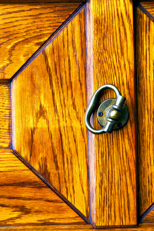 arsago seprio    lombardy  castellanza blur   abstract   rusty brass brown knocker in a  door curch  closed wood italy   cross