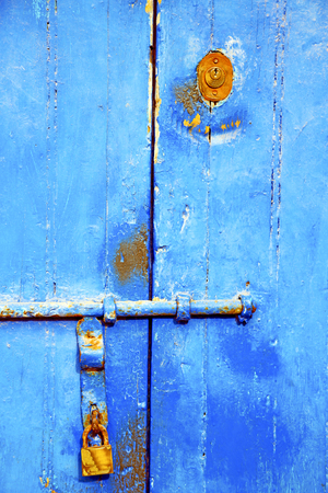 morocco in africa the old wood  facade home and rusty safe padlock Stock Photo