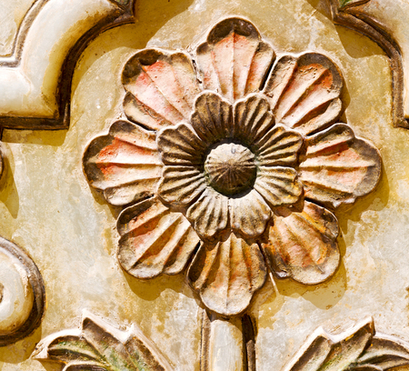 in old iran mousque the column  incision of a flower like abstract background Stock Photo