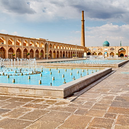 blur in iran   the old square of isfahan prople garden tree heritage tourism and mosque Stock Photo