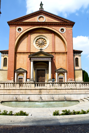 in  the legnano   old   church  closed brick tower sidewalk italy  lombardy Stock Photo