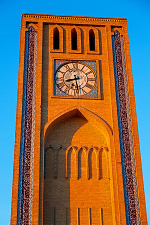 in iran old yazd city and  the antique brick    clock  tower near the sky