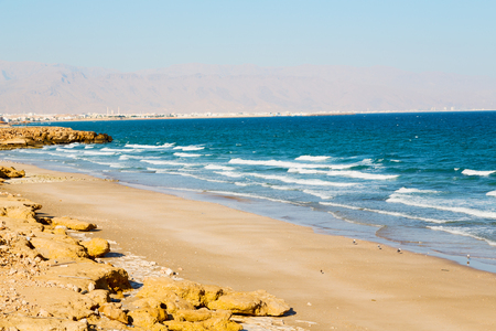 near sandy beach sky and  mountain  in oman arabic sea   the hill