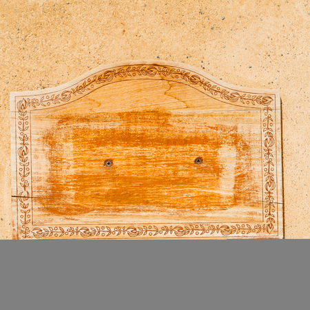 rusty nail: in a concrete wall the wooden vintage empty panel blank and abstract