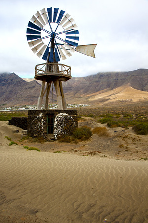 house in  isle of lanzarote  spain africa windmills and the sky   Stock Photo