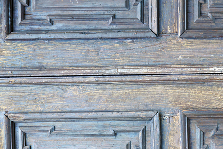 rusty nail: in  italy  patch lombardy    cross milan blur   abstract   rusty brass brown knocker  a  door curch  closed wood