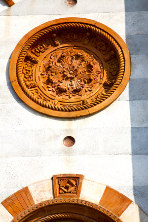 italy  lombardy     in  the mercallo  old   church   closed brick tower   wall rose   window tile