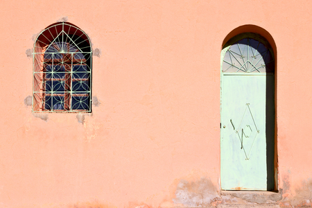 olddoor in morocco  africa ancien and wall ornate brown blue Stock Photo