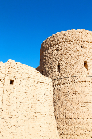 adobe wall: blur in iran the old castle near saryadz brick and sky