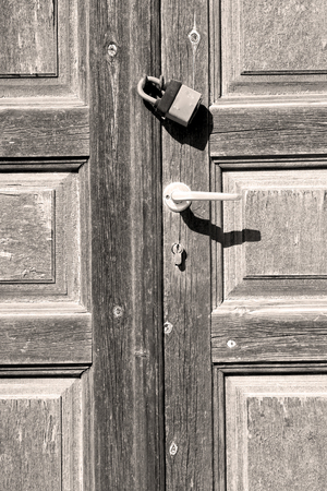 door knob: door    in italy old ancian wood and  traditional                texture nail Stock Photo