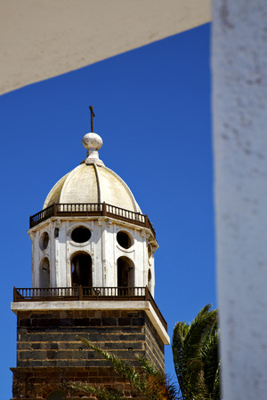 in teguise  arrecife lanzarote  spain the old wall terrace church bell tower plant