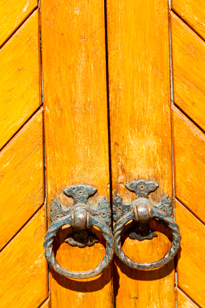 blur in south africa  antique door entrance and      decorative handle for background Stock Photo