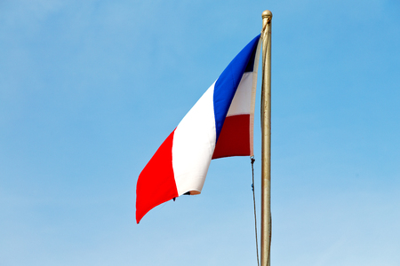 guiana: waving flag in the blue sky  france colour and wave
