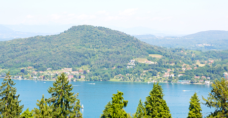 in italy landscape panorama of lake and mountain hill beautiful destination. Stock Photo