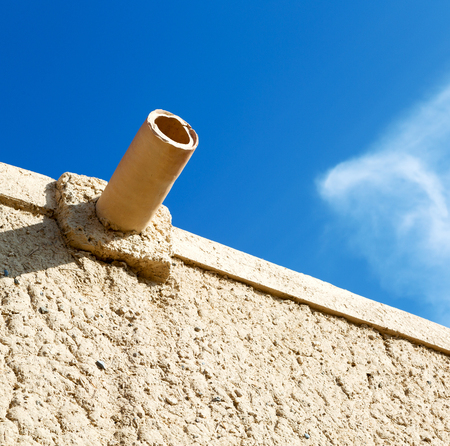 water pipe for the rain in antique oman house Stock Photo