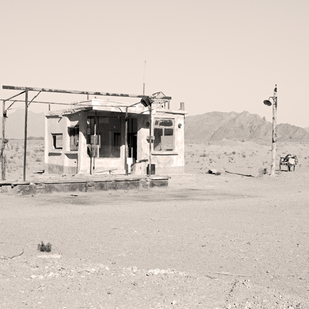 abandoned gas station: in iran old gas station  the desert mountain background and nobody