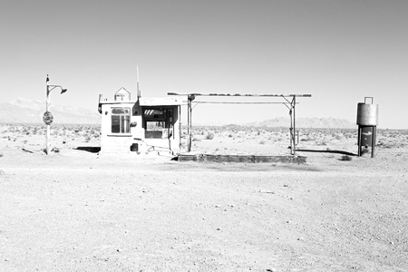 abandoned gas station: blur in iran old gas station  the desert mountain background and nobody