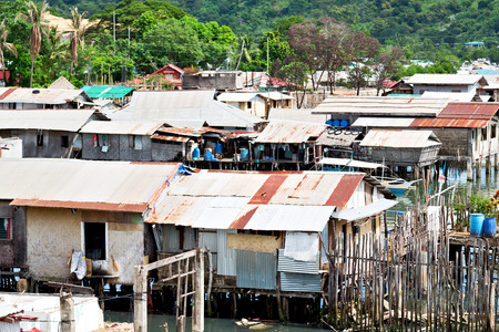 degradation: blur  philippines house in the  slum  for poor people concept of poverty and degradations