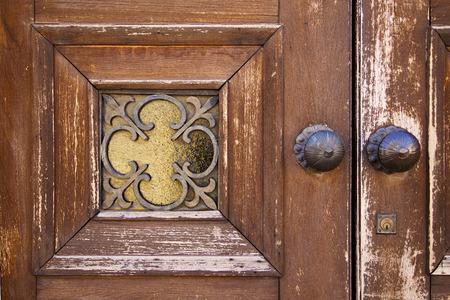 rusty nail: brass brown knocker and wood  glass door caronno varesino varese italy