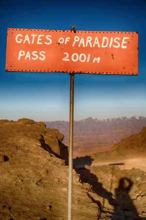 lesotho: in lesotho road sign gate of paradise pass mountain destination Stock Photo