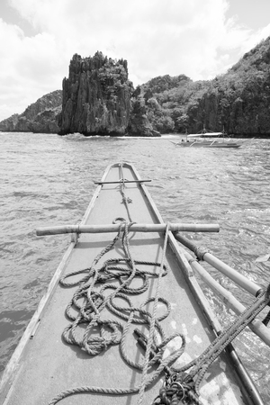 nido: blur  in  philippines   view of the island hill from the prow of a boat