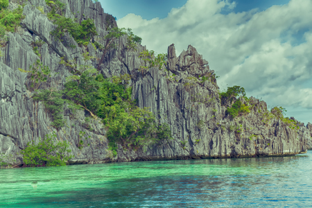 nido: from a boat  in  philippines  snake island near el nido palawan beautiful panorama coastline sea and rock