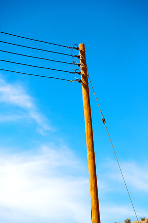 wood pylon energy and current line   in oman the electric cable Stock Photo