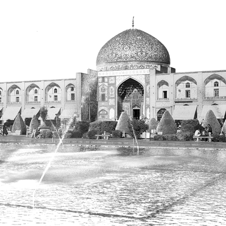 in iran old square mosque and fountain water backlight