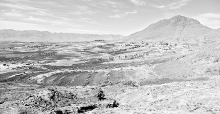 lesotho: blur  in lesotho malealea street village near  mountain and coultivation field