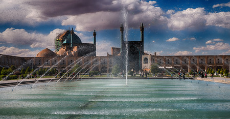 in iran old square mosque and fountain water backlight Stock Photo