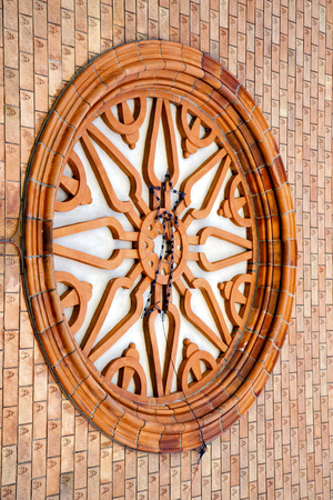 old brick wall: vergiate italy   church  varese  the old door entrance and mosaic sunny daY rose window Stock Photo