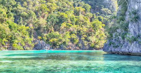 from a boat  in  philippines  snake island near el nido palawan beautiful panorama coastline sea and rock